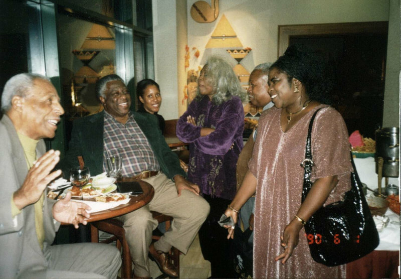 Tess Onwueme with playwrights Ed Bullins and Woodie King Jr., Director Abena Joan Brown and playwright Parker, Chicago, 1995.
